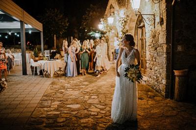Wedding photojournalism reception night bride laughing