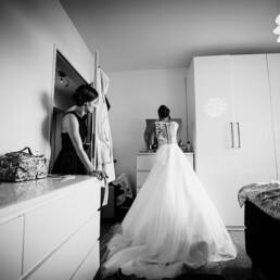 Wedding_getting_ready_bride_beautiful_wedding_dress_bw