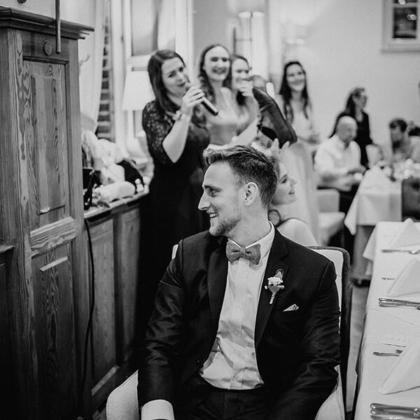 Wedding_photographer_freception_groom_with_ladies