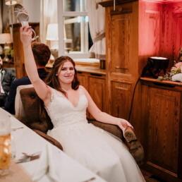 Wedding_photographer_reception_bride_having_fun