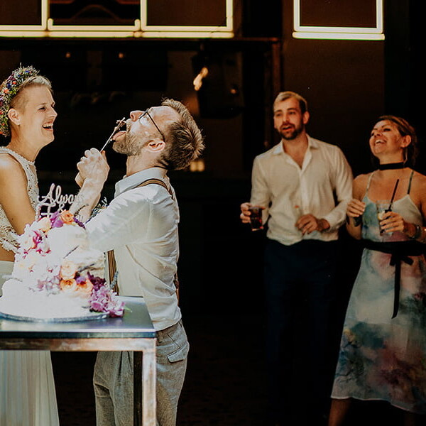 Wedding_photographer_reception_party_bride_groom_cutting_wedding_cake_having_fun