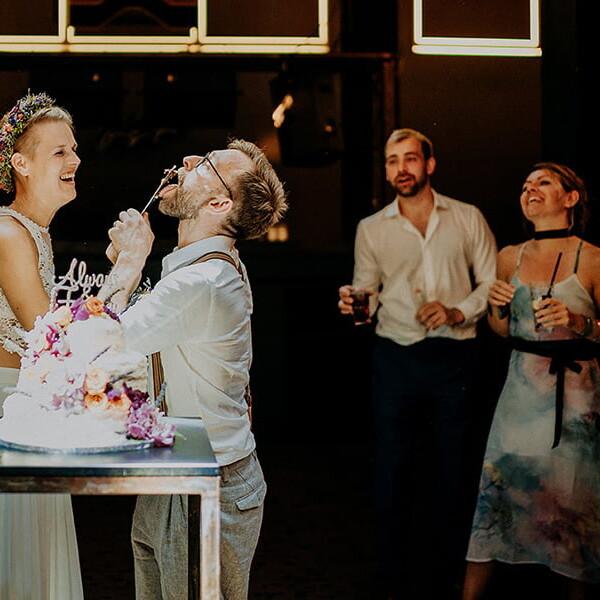 Wedding_photographer_reception_party_bride_groom_cutting_wedding_cake_having_fun