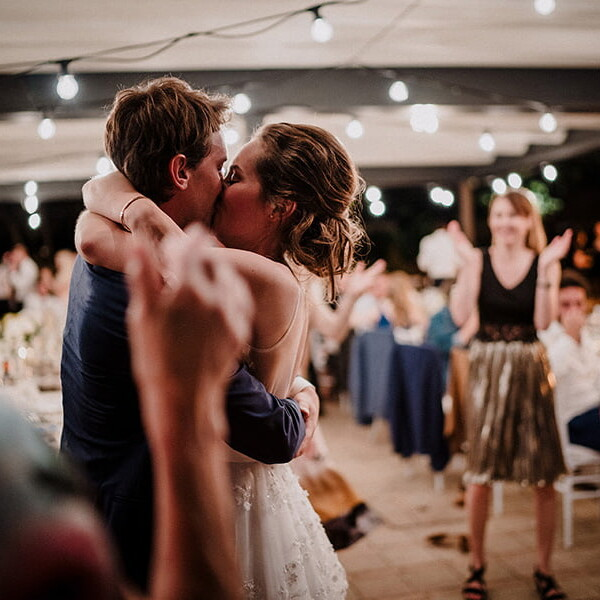 Wedding_photographer_reception_party_married_couple_dancing_kissing_night