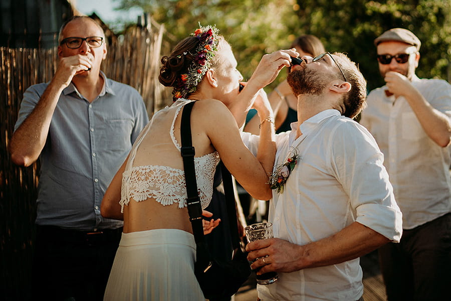 Wedding_photographer_reception_party_married_couple_guests_drinking_shots