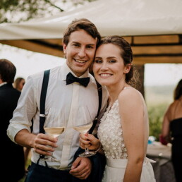 Wedding_photographer_reception_party_married_couple_happy_wine