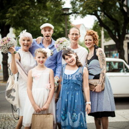 Wedding_photography_after_the_ceremony_bride_groom_with_family_sweet